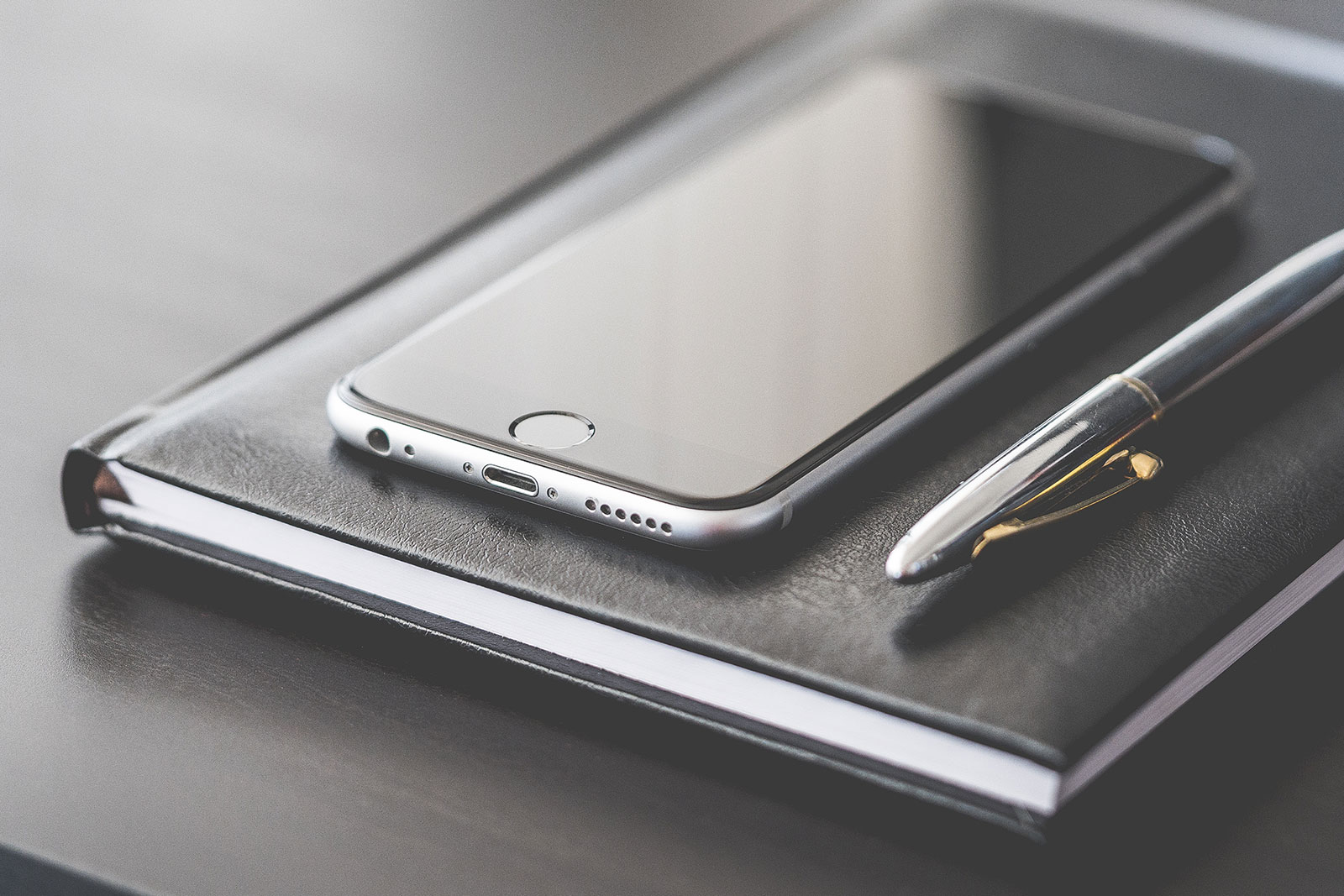 A Super Business Gear: Smartphone, Silver Pen & Diary